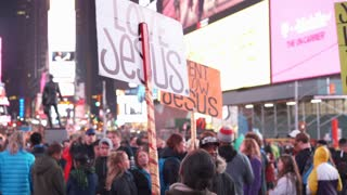 People sharing the love of Jesus with signs in Times Square