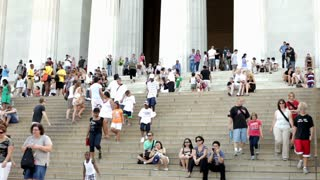 People sitting on steps of Lincoln Memorial