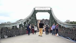 People visiting Eisener Steg bridge in Frankfurt Germany 4k