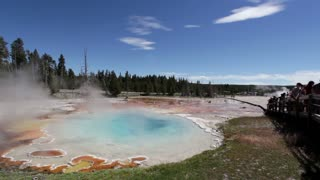 People visiting Silex Spring at Yellowstone