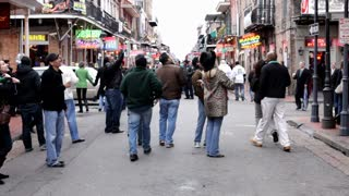 People Walking Down Bourbon Street