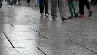 People walking down city sidewalk in Frankfurt Germany feet view 4k