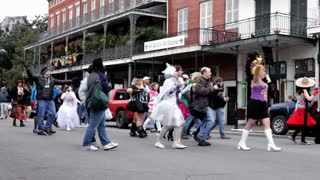 People Walking Down Road Celebrating Mardi gras