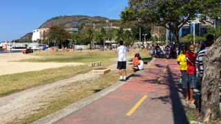 People walking on path near Botafoga beach in Rio 4k