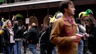 People walking through Bourbon Street