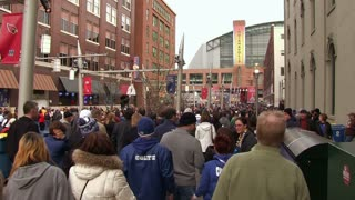 People walking Towards Indianapolis Stadium
