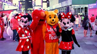 People wearing popular character costumes in Times Square NYC 4k