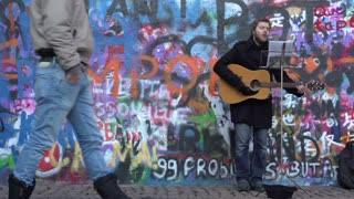 Performer in front of the Lennon wall in Prague
