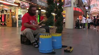 Performing man drumming on Fremont Street