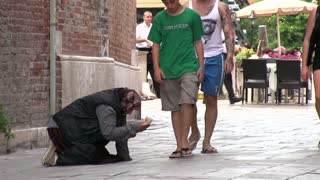 Person asking for money in Venice Italy