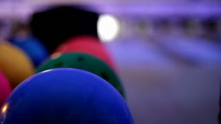 Person bowling during lunar bowl