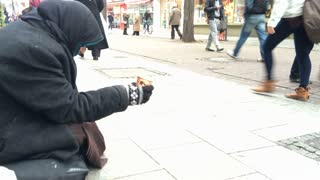 Person on streets of Frankfurt asking for money