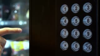 Person purchasing item from vending machine using keypad 4k