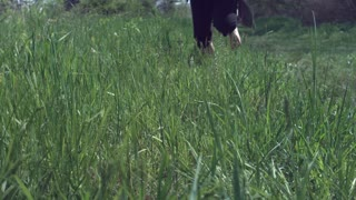 Person running through grass in slow motion