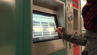 Person using ticket machine in Frankfurt Subway station 4k