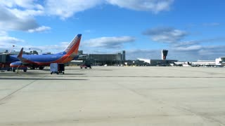 Philadelphia airport driving by Southwest Airline plane at gates