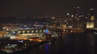 Pittsburgh establishing shot of city with Football stadium at night 4k