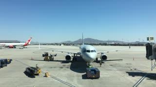 Plane being prepared for take off at terminal gate McCarran Airport 4k