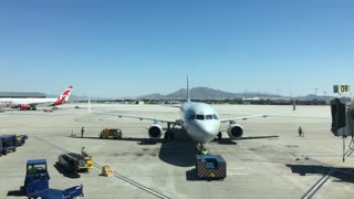 Plane taxiing back from gate at McCarran International Airport 4k
