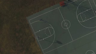 Player on basketball court extreme aerial view 4k