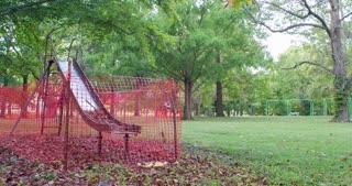 Playground slide quarantined in park pan shot 4k
