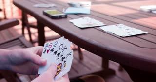 Playing Bid Euchre card game 4k