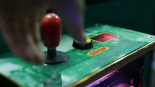 Playing claw game and pressing drop button