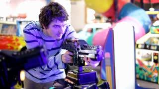 Playing Gun Game at the Arcade