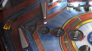 Playing Ironman pinball game with ball going down hole 4k
