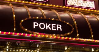 Poker sign lit up on casino 4k