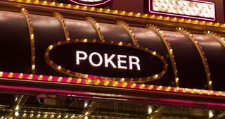Poker sign lit up on casino 4k