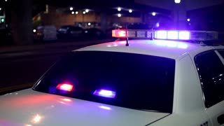 Police car at night with lights flashing
