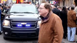 Police Car driving through crowd Mardi Gras
