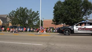 Police car goes by in Fairborn July 4th Parade 4k