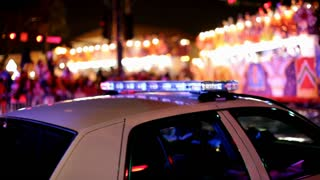 Police Car with lights on in mardi gras parade