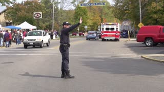 Police man directing traffic slow motion