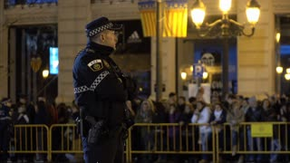 Police man standing in front of crowd waiting for Fallas celebration