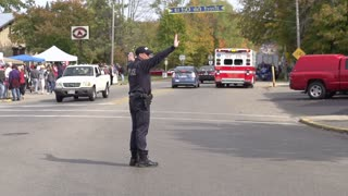 Police man stopping traffic slow motion