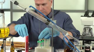 Police officer analyzing evidence in lab