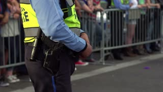 Police officer with hand on waist belt