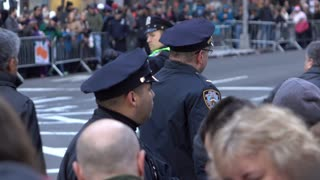 Police officers along fence line at Macys Parade 2015 4k