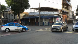 Police sitting at corner of intersection in Vila Isabel Rio de Janeiro Brazil 4k
