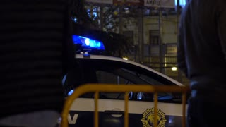 Police vehicle of Valencia parked along side fence 4k