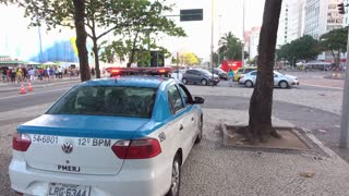 Police vehicle with flashing lights at Copacabana in Rio 4k