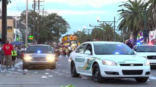 Police vehicles coming through Endymion parade