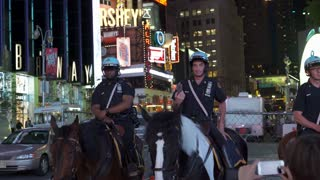 Policemen on horseback in downtown Times Square New York 4k