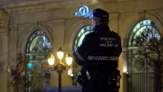 Policia Local Valencia standing guard at evening festivities 4k