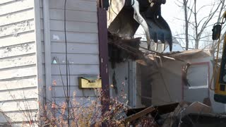 Portion of House ripped apart by Claw