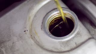 Pouring car oil into engine slow motion