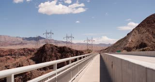 Power lines spanning canyon seen from bridge 4k.